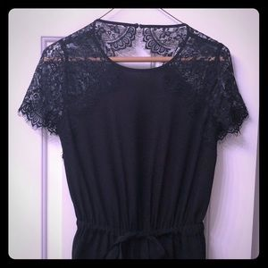 Black jumpsuit with lace sleeves